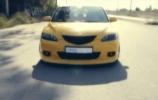 Mazda 3 - žemiau ir plačiau